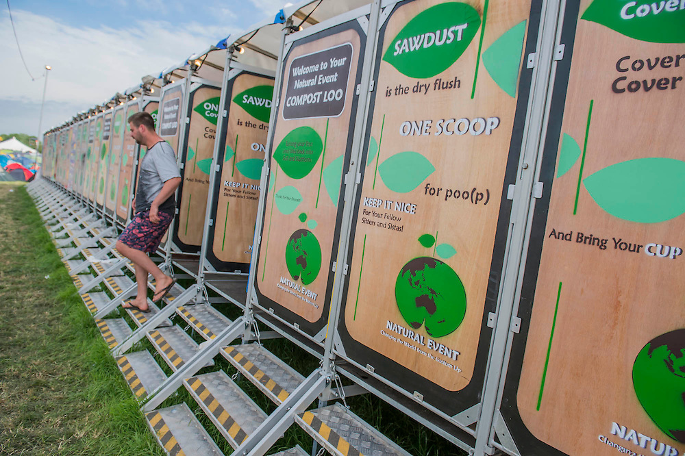 Composting toilets. The 2015 Glastonbury Festival, Worthy Farm, Glastonbury.