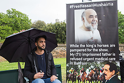 Windsor, UK. 11 May, 2019.  Ali Mushaima, son of Hassan Mushaima, the leader of a major opposition party in Bahrain, fasts outside the Royal Windsor Horse Show site in the grounds of Windsor Castle to draw attention to the mistreatment of his 71-year-old father, who has been imprisoned, tortured and denied medical care in Bahrain, on the occasion of the hosting by the Royal Family of King Hamad bin Isa al-Khalifa of Bahrain at the equestrian event. In 2015, 15 MPs wrote to the FCO to call for action to urge Bahrain to end the mistreatment of Hassan Mushaima. Credit: Mark Kerrison/Alamy Live News