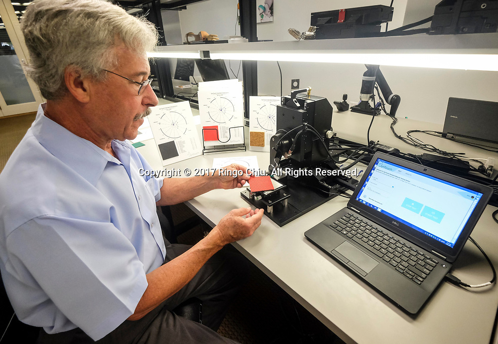 Gerald E. Loeb, CEO of SynTouch, demonstrates their robot fingers.(Photo by Ringo Chiu)<br /> <br /> Usage Notes: This content is intended for editorial use only. For other uses, additional clearances may be required.