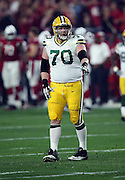 Green Bay Packers guard T.J. Lang (70) points during the NFL NFC Divisional round playoff football game against the Arizona Cardinals on Saturday, Jan. 16, 2016 in Glendale, Ariz. The Cardinals won the game in overtime 26-20. (©Paul Anthony Spinelli)