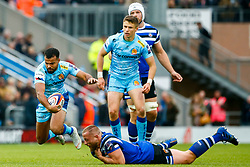 Tom O'Flaherty of Exeter Chiefs escapes the challenge from Max Lahiff of Bath Rugby - Mandatory by-line: Ryan Hiscott/JMP - 03/11/2018 - RUGBY - Sandy Park Stadium - Exeter, England - Exeter Chiefs v Bath Rugby - Premiership Rugby Cup