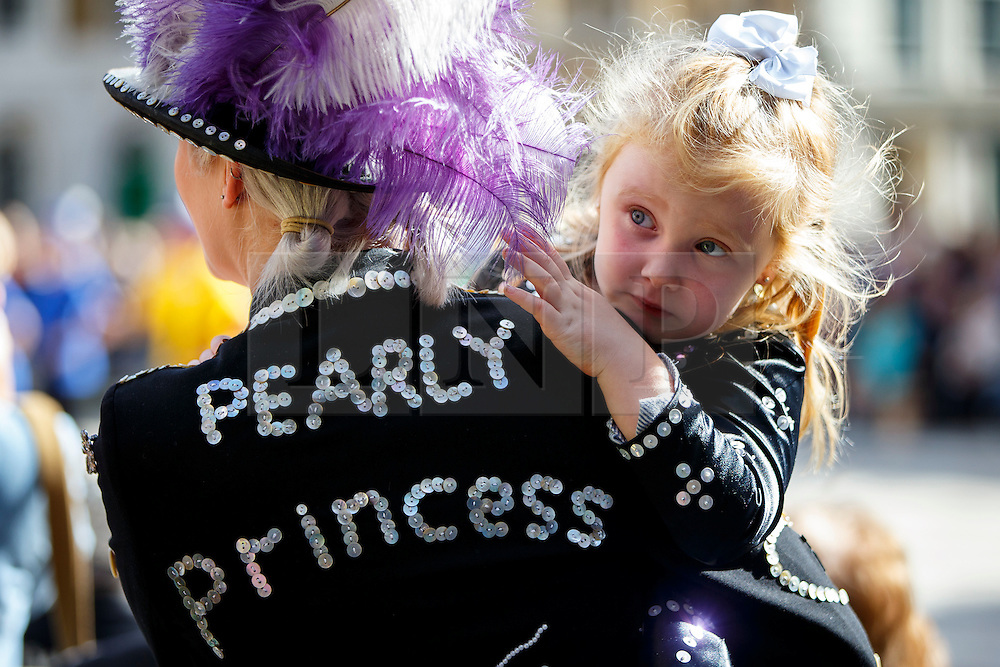 © Licensed to London News Pictures. 25/09/2016. London, UK. Pearly Kings and Queens Harvest Festival celebrations take place at Guildhall Yard in London as 140-year-old Pearly tradition continues on 25 September 2016. Dressed in dark suits covered in hundreds of bright pearl buttons, the Pearly Kings and Queens of London follow the charity tradition of Henry Croft, an orphan who worked as a street sweeper in the market of Somers Town, London in the 19th century. Photo credit: Tolga Akmen/LNP