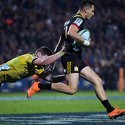 Hurricanes' Jordie Barrett tries to tackle Shaun Stevenson (Chiefs) during the Super Rugby match between the Chiefs and Hurricanes at FMG Stadium in Hamilton, New Zealand on Friday, 13 July 2018. Photo: Dave Lintott / lintottphoto.co.nz