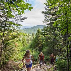 Hikers on Deboullie Mountain in Aroostook County, Maine. Deboullie Public Reserve Land.
