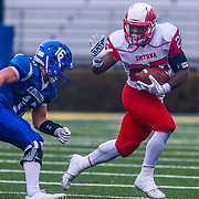 Smyrna Eagles running back WILLIAM KNIGHT (25) stiff arms Middletown's NICHOLAS JOHNSTON (16) in the fourth quarter of the 2017 DIAA Division I state championship game between the Smyrna Eagles and Middletown Cavaliers Saturday, Dec. 02, 2017 at Delaware Stadium in Newark, DE.