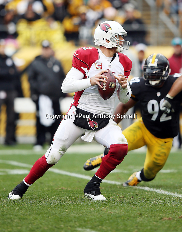 Arizona Cardinals quarterback Carson Palmer (3) is pressured by Pittsburgh Steelers outside linebacker James Harrison (92) as he drops back to pass during the 2015 NFL week 6 regular season football game against the Pittsburgh Steelers on Sunday, Oct. 18, 2015 in Pittsburgh. The Steelers won the game 25-13. (©Paul Anthony Spinelli)