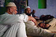Taking shelter from a hot day at the inner courtyard at a small Delhi mosque.