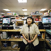 KIVALINA, ALASKA - 2007. Anita Adams in the Kivalina Native Store.