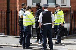 Knightsbridge, London, May 19th 2017. A man is arrested near the Ecuadorian embassy in Knightsbridge as the press gather outside following news that Wikileaks founder Julian Assange has had rape charges against him dropped by Swedish prosecutors. The arrest follows a brief episode where a suspicious package was investigated by police, but it is uncertain whether the arrest was connected.