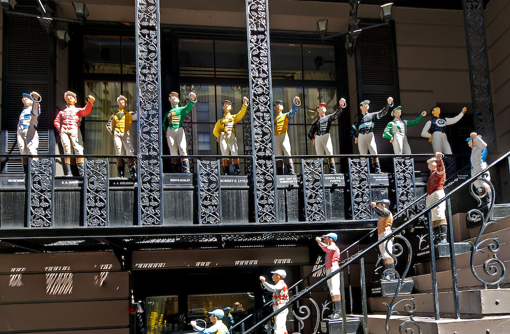 21 Club, restaurant and former prohibition-era speakeasy, painted cast iron lawn jockey statues, 21 West 52nd Street, Manhattan, New York City, New York, USA