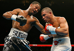 "November 10, 2007; New York, NY, USA;   WBA Welterweight Champion Miguel Cotto (white trunks) and ""Sugar"" Shane Mosley (black trunks) trade punches during their 12 round fight  at Madison Square Garden in New York, NY.   Cotto won the fight via unanimous decision."