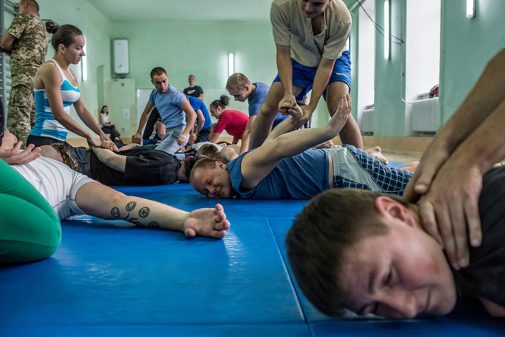 LVIV, UKRAINE - OCTOBER 5, 2015: Recruits take part in tactical training for new patrol police officers, learning how to subdue and handcuff a subject, in Lviv, Ukraine. In an effort to reform the notoriously corrupt Ukrainian police force, an entirely new force has been established in several cities, including Kiev and Lviv, with a primary focus on patrolling the streets. CREDIT: Brendan Hoffman for The New York Times