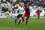 Preston North End Defender Tom Clarke and Queens Park Rangers defender James Perch (24) battle during the Sky Bet Championship match between Preston North End and Queens Park Rangers at Deepdale, Preston, England on 19 March 2016. Photo by Pete Burns.