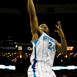 December 21, 2011; New Orleans, LA, USA; New Orleans Hornets power forward Carl Landry (24) shoots against the Memphis Grizzlies during the first quarter of a preseason game at the New Orleans Arena.  The Hornets defeated the Grizzlies 95-80. Mandatory Credit: Derick E. Hingle-US PRESSWIRE