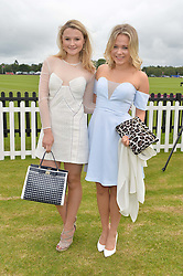 Left to right, AMBER ATHERTON and POPPY JAMIE at the Cartier Queen's Cup Final polo held at Guards Polo Club, Smith's Lawn, Windsor Great Park, Egham, Surrey on 15th June 2014.