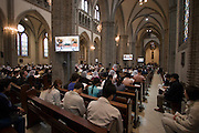 Myeong-dong Cathedral (catholic). Sunday service. Transmission via plasma screens.