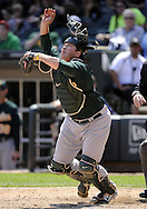 CHICAGO - JUNE 12:  Catcher Landon Powell #11 of the Oakland Athletics tosses his mask while attempting to field a bunt during the game against the Chicago White Sox on June 12, 2011 at U.S. Cellular Field in Chicago, Illinois.  The White Sox defeated the Athletics 5-4.  (Photo by Ron Vesely)   Subject:  Landon Powell