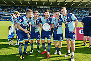 Wycombe Wanderers Adam El-Abd(6), Scott Kashket(11), Joe Jacobson(3), Dominic Gape(4) and Will De Havilland(19) celebrate promotion after the EFL Sky Bet League 2 match between Wycombe Wanderers and Stevenage at Adams Park, High Wycombe, England on 5 May 2018. Picture by Alistair Wilson.