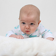 A studio portrait shot of a three month old baby girl.  Photo Tim Clayton
