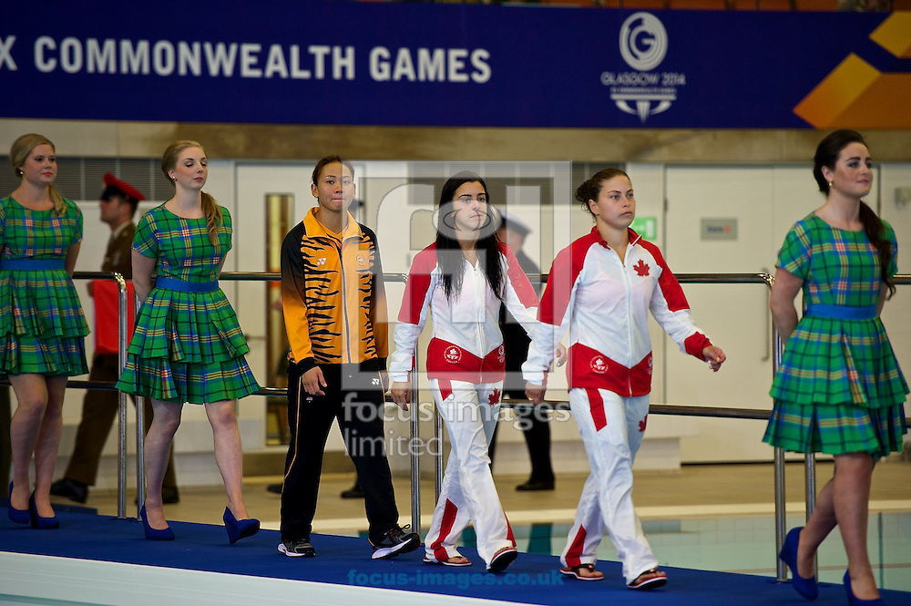 The medalists from the Women's 10 Metre Platform Final (L-R Rinong Pandelela Pamg of Malaysia (silver), Meaghan Benfeito of Canada (gold) and Roseline Filion of Canada (bronze)) head to the medal ceremony on Diving Day Two at Royal Commonwealth Pool during Glasgow 2014 Commonwealth Games <br /> Picture by Ian Wadkins/Focus Images Ltd +44 7877 568959<br /> 31/07/2014