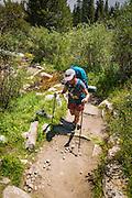 Backpacker on the Big Pine Lakes Trail, John Muir Wilderness, Sierra Nevada Mountains, California USA