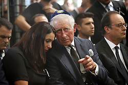 September 30, 2016 - Jerusalem, ISRAEL - Britain's Prince Charles, center, speaks to Israeli Minister of Sport and Culture Miri Regev, as French President Francois Hollande, right, sits nearby, during the burial ceremony at the funeral of former Israeli President Shimon Peres at Mount Herzl Cemetery in Jerusalem, Friday, Sept. 30, 2016. (Credit Image: © Prensa Internacional via ZUMA Wire)