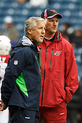 October 24, 2010; Seattle, WA, USA;  Seattle Seahawks head coach Pete Carroll (left) talks with Arizona Cardinals head coach Ken Whisenhunt before the game at Qwest Field.