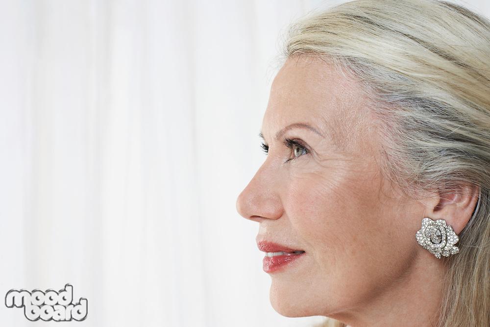 Senior woman in studio profile close up