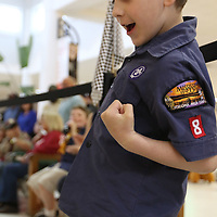 Brayden Briggs, 7, of pack 8 celebrates as his car won its first heat Saturday at the Mall at Barnes Crossing food court.  Winners of today will advance to the Yocona Area Council Pinewood Derby at the Tupelo Auto Museum next month