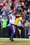 Minnesota Vikings strong safety Andrew Sendejo (34) breaks up a third quarter end zone pass intended for leaping Washington Redskins wide receiver Jamison Crowder (80) during the 2017 NFL week 10 regular season football game against the Washington Redskins, Sunday, Nov. 12, 2017 in Landover, Md. The Vikings won the game 38-30. (©Paul Anthony Spinelli)