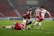 Blackburn Rovers midfielder Corry Evans (29) beats two Doncaster Rovers players during the EFL Sky Bet League 1 match between Doncaster Rovers and Blackburn Rovers at the Keepmoat Stadium, Doncaster, England on 24 April 2018. Picture by Mick Atkins.