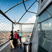 Tourists admire the view of Mexico City from the 44th floor of the Torre Latinoamericana building.