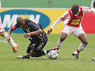 THULANI SERERO wins the ball from Sibusiso Vilakazi during the PSL match between Ajax Cape Town and Bidvest Wits held at Newlands Stadium in Cape Town on 13 September2009 ..Photo by Shaun Roy/www.sportzpics.net.+27 21 785 6814..