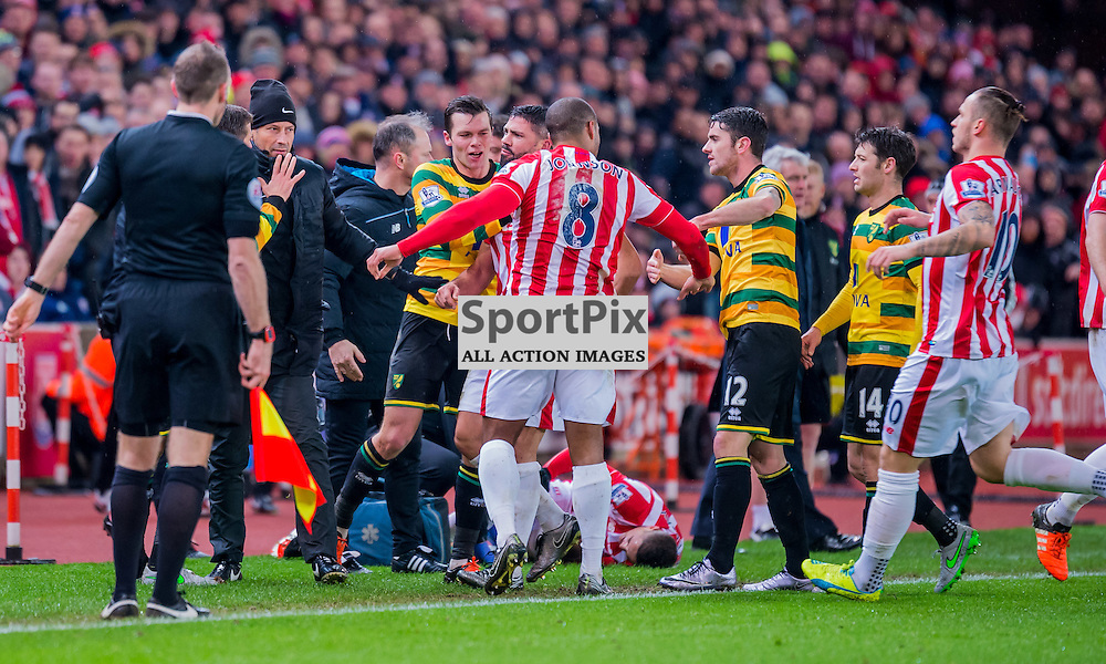 players from both sides clash in the Premier League match between Stoke City and Norwich City