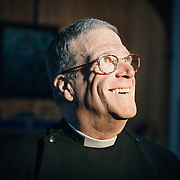 Canon Tom Miller, new-yorker and Priest-in-Charge of St Mary's Church, Stromness<br /> ©Damian Shields/The Economist/1843 Magazine