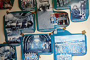 Magazine cuttings and pictures are on show on the wall of the local deli at Tower Colliery, the last deep mine in Wales, on Tuesday, June 19, 2007, in Hirwaun, Vale of Neath, South Wales. The time is ripe again for an unexpected revival of the coal industry in the Vale of Neath due to the increasing prize and diminishing reserves of oil and gas, the uncertainties of renewable energy sources, and the technological advancement in producing energy from coal while limiting emissions of pollutants, has created the basis for valuable investment opportunities and a possible alternative to the latest energy crisis. Unity Mine, in particular, has started a pioneering effort to revive the coal industry in the area, reopening after more than 8 years with the intent of exploiting the large resources still buried underground. Coal could be then answer to both, access to cheaper and paradoxically greener energy and a better and safer choice than nuclear energy as a major supply for the decades to come. It is estimated that coal reserves in Wales amount to over 250 million tonnes, or the equivalent of at least 50 years of energy supply, while the worldwide total coal could last for over 200 years as a viable resource compared to only a few decades of oil and natural gas.
