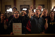 Dave Leucinger, left, and Chris Malueg, right, and other protestors chant as Republican representatives manuever to quickly pass a bill to eliminate collective bargaining at the State Capitol in Madison, Wisconsin, February 24, 2011.