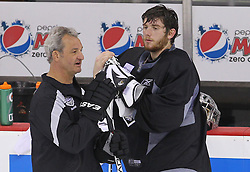 May 29; Newark, NJ, USA; Los Angeles Kings head coach Darryl Sutter and Los Angeles Kings goalie Jonathan Quick (32) during Stanley Cup Finals media practice day at the Prudential Center.