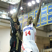 Delaware 87ers Guard Vander Blue (14) drives towards the basket as Erie BayHawks Forward Terrence Jennings (21) defends in the first half of a NBA D-league regular season basketball game between the Delaware 87ers (76ers) and the Erie BayHawks (Knicks) Tuesday, Feb. 11, 2014 at The Bob Carpenter Sports Convocation Center, Newark, DE