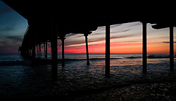© Licensed to London News Pictures. <br /> 11/08/2017. <br /> Saltburn by the Sea, UK.  <br /> <br /> The sky beyond the pier glows red at sunrise in the North Yorkshire coastal town of Saltburn by the Sea.<br />   <br /> Photo credit: Ian Forsyth/LNP