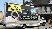 Picture date: 24th July 2013.<br /> Mobile billboards carrying a warning of &quot;Go Home or Face Arrest&quot; as part of the controversial 2013 Home Office initiative to reduce illegal immigration. The controversial, hard-htting vans were driven through Ealing, Barking and Dagenham, Hownslow, Redbridge, Brent and Barnet.<br /> The vans were brought up today in Parliament as Home Secretary Amber Rudd has been called to resign after challenging the 'Windrush generation' on their immigration status.