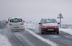&copy; Licensed to London News Pictures. <br /> 27/12/2014. <br /> <br /> Castleton, United Kingdom.<br /> <br /> Drivers make their way cautiously over the snow covered roads of the North Yorkshire Moors near Castleton after overnight snowfall caused disruption in some parts of the country.<br /> <br /> Photo credit : Ian Forsyth/LNP