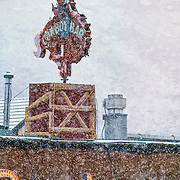 Snow falling on the famous Million Dollar Cowboy Saloon sign in Jackson Hole, WY.