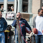 05 November 2012: Patriots linebacker Jerod Mayo with Patriots owners Robert and Jonathan Kraft  before Aerosmiths' free concert  in Allston.  Thousands of fans filled Commonwealth Avenue to watch Aerosmith play in front of the building (No. 1325) where band members once lived.  Boston, MA. ***Editorial Use Only*****