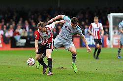 Sam Jones of Grimsby Town applies pressure on Carl Winchester of Cheltenham Town  - Mandatory by-line: Nizaam Jones/JMP - 17/04/2017 - FOOTBALL - LCI Rail Stadium - Cheltenham, England - Cheltenham Town v Grimsby Town - Sky Bet League Two