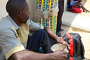 A patients carer sitting outside Mbarara Hospital, Uganda.