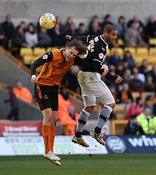 Wolves' Richard Stearman and Watford's Adlene Guedioura compete for a high ball - Photo mandatory by-line: Paul Knight/JMP - Mobile: 07966 386802 - 07/03/2015 - SPORT - Football - Wolverhampton - Molineux Stadium - Wolverhampton Wanderers v Watford - Sky Bet Championship
