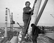 """AMAZING Photo Film discovered Documenting Work In Chernobyl <br />Chernobyl worker Aleksandr Shubovskiy captures rare images <br /><br />During one of the days in 1979-80, when the erection of Ventilation Stack VT-2 common for the third and fourth (not existed at that time) Chernobyl NPP Units was coming to the end, Aleksandr Shubovskiy, who was working within a combined installation crew in a company named """"Spetsenergomontazh"""", arranged with the colleagues a small photo session on his own,They had their pictures taken.<br /><br />The author processed the film and put it on a wardrobe without printing until he had time to print the images. The moment to print the film somehow did not happen, while in February 1986 Aleksandr hit the road for a on a different site in Yakutia. And there he was caught by news about the accident at Chernobyl.<br /><br />A year later, when a Aleksandr  managed to get into his looted flat in the evacuated Pripyat, he discovered an untouched package with films. He brought them home and… forgot for almost 40 years…the printed photographs which no one and never have seen before until now<br /><br />Photo shows:  Against all H&S rules. At height with a cigarette but without any safety. <br />©Aleksandr Shubovskiy/Exclusivepix Media"""