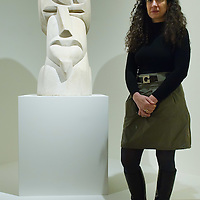 VENICE, ITALY - JANUARY 28:  Vivien Greene, Curator of 19th- and Early 20th-Century Art at the Guggenheim Museum New York poses next to Henri Gaudier-Brzeska: Hieratic Head of Ezra Pound at the press launch of the Vorticist exhibition on January 28, 2011 in Venice, Italy. The Vorticists: Rebel Artists in London and New York, 1914-1918, is the first exhibition devoted to Vorticism to be presented in Italy will be open at the Peggy Guggenheim Collection from  January 29 through May 15, 2011.