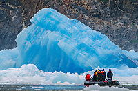 Massive blue iceberg and zodiac from the South Sawyer Glacier in Tracy Arm - Fords Terror Wilderness, Southeast Alaska.